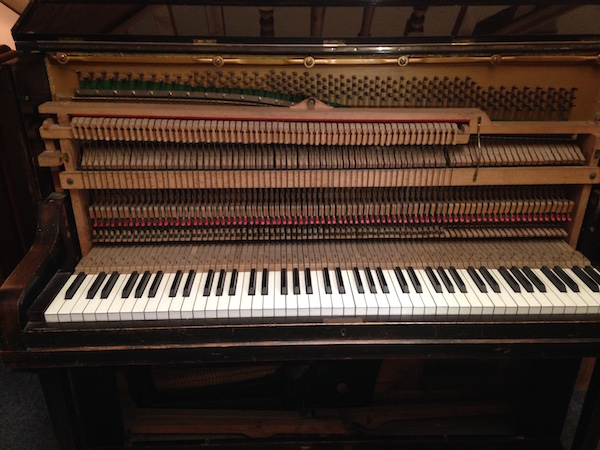 Straight strung piano with overdamped action.